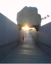 21' tall granite quarry fragment in a permanent installation at the Los Angeles County Museum of Art. This is an April 20th sunset with near perfect sun- to- stone alignment.  Image courtesy of Stephen Knudsen.